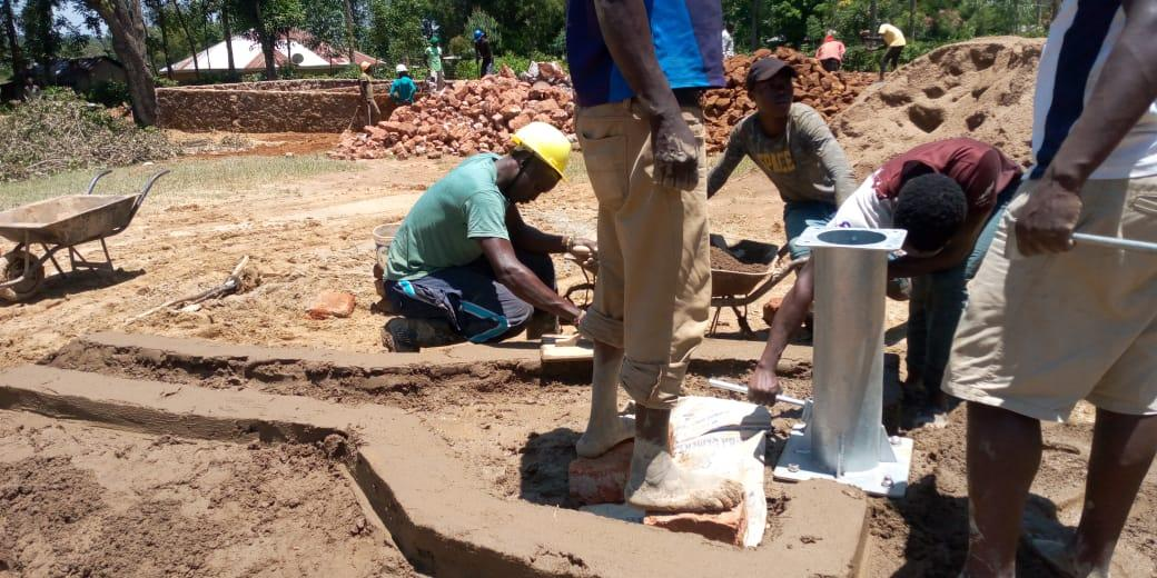 Workers close the borehole