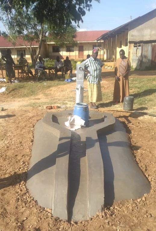 Completely installed hand pump with concrete drain